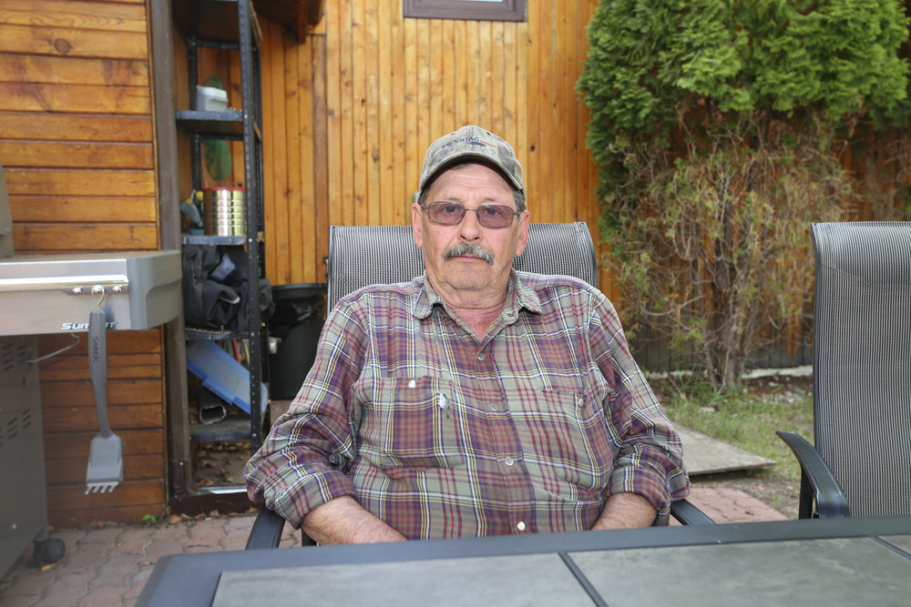 Steve Yurkiw, 67, sits at a cabin north of Lac La Biche, Alta. on Sunday, May 15, 2016. After losing his Beacon Hill home, he is debating if he should return to Fort McMurray. Vincent McDermott/Fort McMurray Today/Postmedia Network