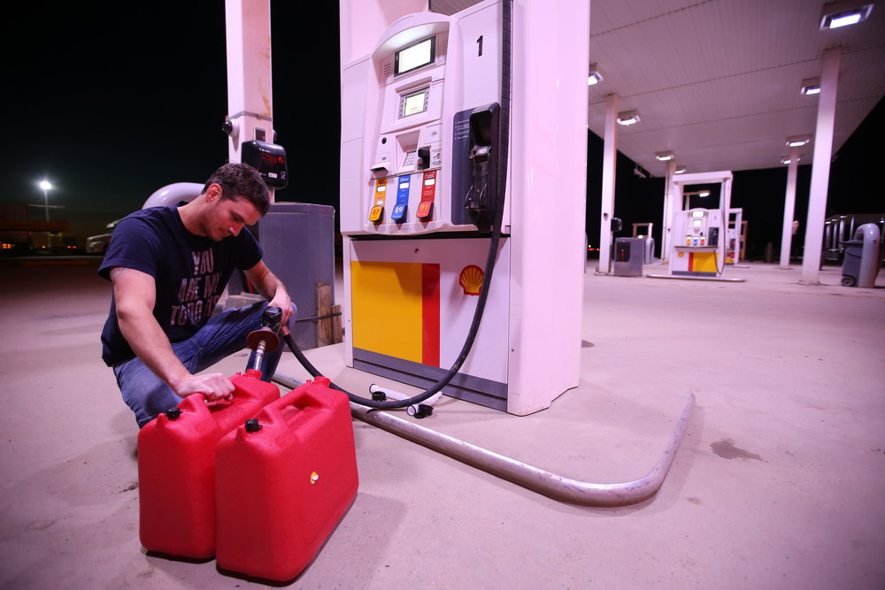 Andrew Martell, 26, fills up on gas at a Shell station in Grassland, Alta., approximately 250 kilometres south of Fort McMurray, Alta., on the evening of Tuesday, May 31, 2016. Vincent McDermott/Fort McMurray Today/Postmedia Network