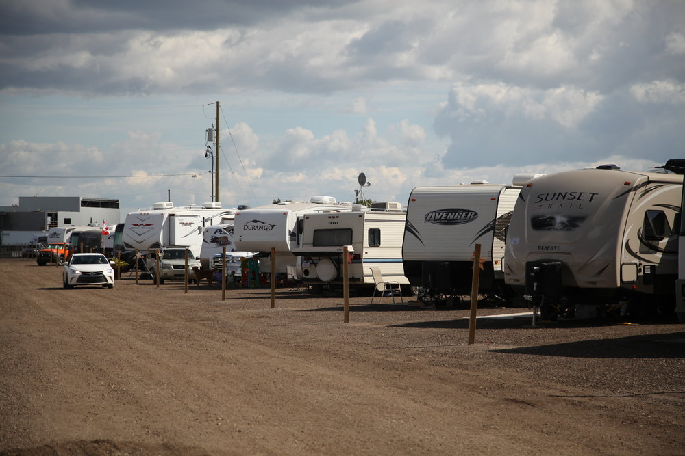 One of the rows of RVs parked at a temporary campsite at Abraham's Land, near the top of Dickensfield on August 23, 2016. The grounds are set up with water and electricity for displaced residents waiting for more permanent housing solutions. Olivia Condon/ Fort McMurray Today/ Postmedia Network