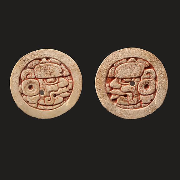 Maya Carved Shell Disks with Cinnibar