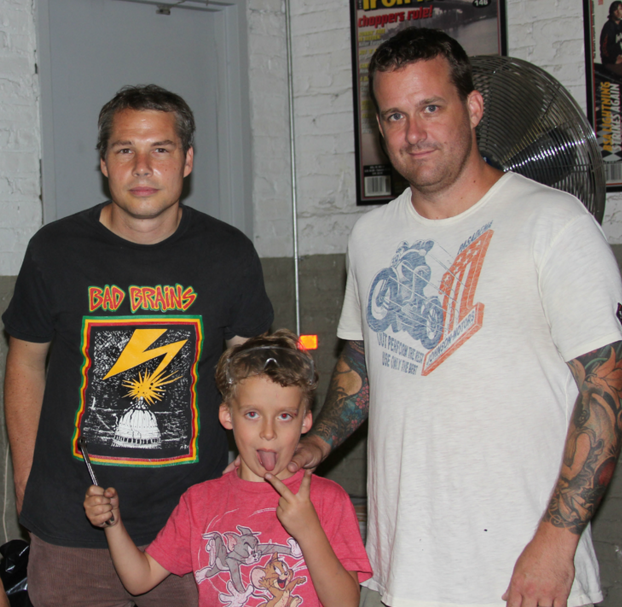 Shepard Fairey with Aidan and Bobby Seeger at Indian Larry Motorcyle in Brooklyn, New York