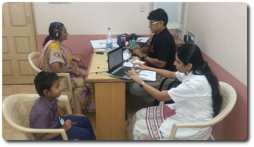 Tirth Dineshkumar Rana getting his hearing tested by Quadio employee, Vaishnavi Bhosale