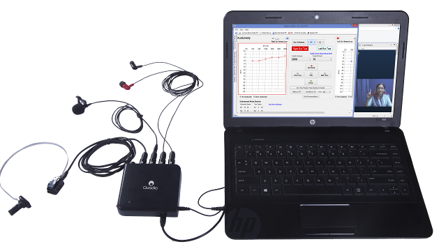 Quadiometry setup with a laptop and a Quadio audiometer (Quadiometer) connected to the laptop as well as a bone conductor, headphones and microphone