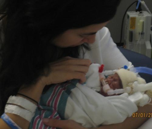 Paulina holding Isabelle for the first time.