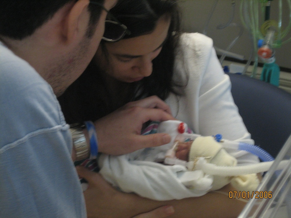 Paulina and Josh holding Isabelle for the first time.
