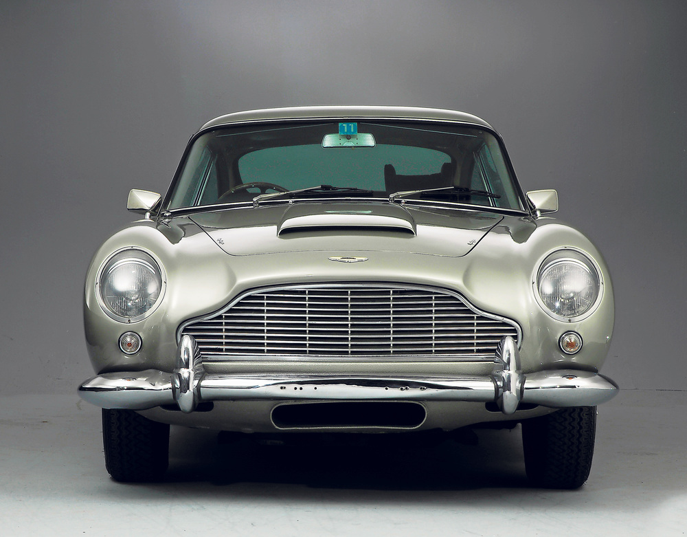 The Driving Position Of An Aston Martin DB5 Has A Delightful Vintage Feel  To It, With Lots Of Big, Round Instruments Set Within A Painted Metal  Dashboard.