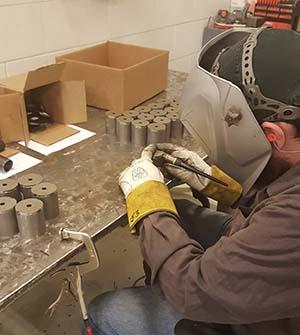 Pre-welding adaptors for Chevrolet tailgates.