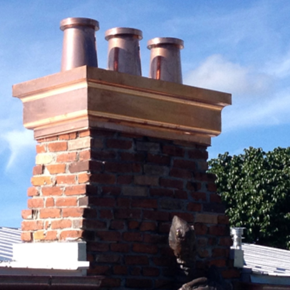 decorative options available:  this custom copper chimney cap adds an attractive detail to the house!