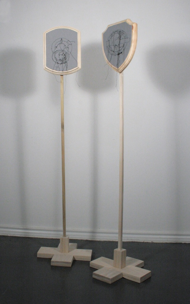 Figure 2.  Never Too Far Apart  (2012), Thread, felt, wood, 40 x 24 inches
