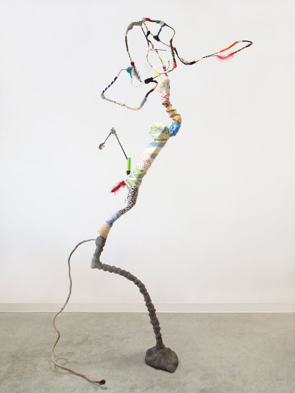 "Gina Herrera,  Rocking for the Future,  Assorted found materials, 85 x 54 x 21 inches   ""Whimsical, exuberant and deeply off-kilter, an assemblage of natural objects and post-consumer waste takes on a figure-like form engaged in a hip jutting, raucous dance."""