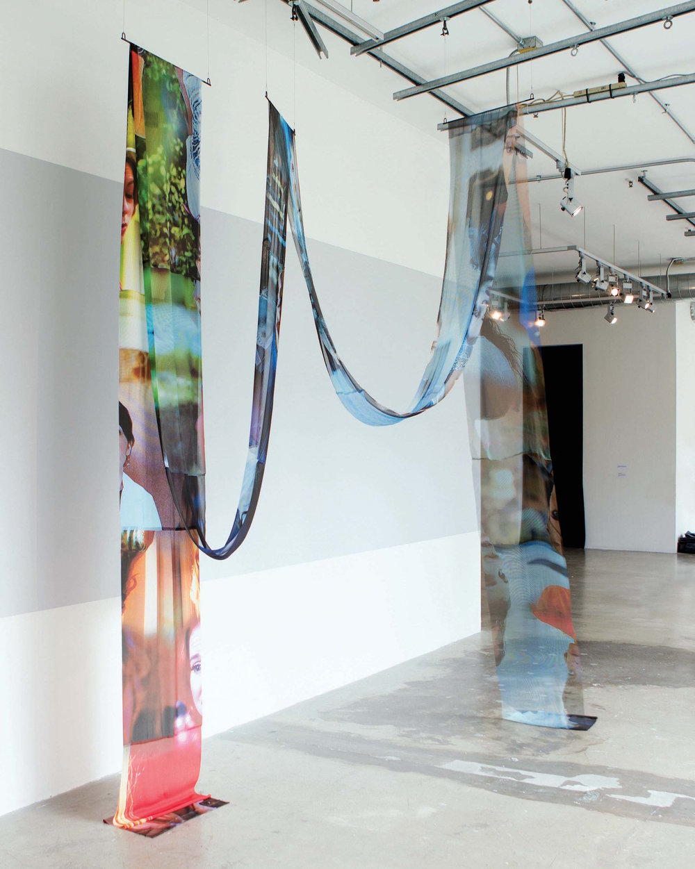 Shannon Crider, TV Guides (Installation View), 2016, Digitally printed sheer fabric, 576 x 18 inches, dimensions variable