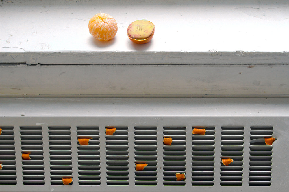 Squeezing Sorrow from an Orange  (Installation view), Orange peels, scent, radiator, School of the Art Institute of Chicago, 2017.