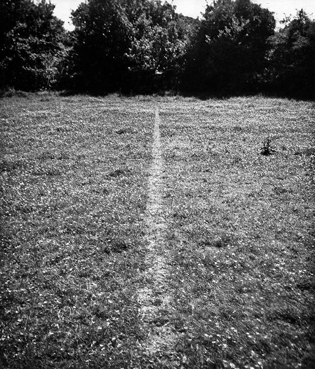 "We're seeing a lot of artists today addressing mindfulness, particularly as it relates to themes of trauma, phenomenology, loss, and interbeing. Thus, over the next few months we will be probing the art historical archive for precursors in ancient and modern art. To kick off #mindfulmonday we propose a connection between Richard Long's seminal photograph ""Line Made by Walking"" (1967, Tate), the British tradition of hill walking enshrined today in the 2000 UK Countryside & Rights of Way Act, and Buddhist walking meditation. #art #artist #artbook #artmag #artblog #contemporaryart #drawing #painting #photography #sculpture"