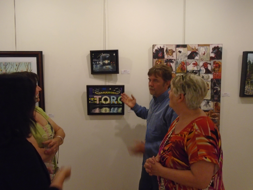 Artist Steve Wilson showing his artwork at the opening of the Hittite Gallery show.