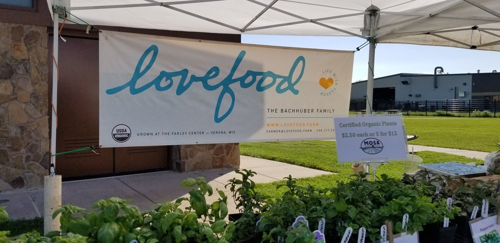 Lovefood LLC -  We are David, Abby, and Soleia Bachhuber and we truly enjoy growing food for our community! We farm with love and devotion and with a deep sense of partnership with our customers as well as the land, plants, soil and animals big and small.Our farm dream began with a cherry tomato plant in a five-gallon bucket on a fire escape in 1999. Since then, David has been absolutely hooked on growing food. After years of an ever-expanding home garden gobbling up every inch of lawn, the hobby began to shift to a true business endeavor. In 2014, Lovefood was founded on an acre of rented land and we were off and running.We now grow a wide variety of certified organic veggies, herbs, and fruits in Verona, WI and sell through our CSA, at farmers markets, and wholesale to local restaurants and grocery stores.www.lovefood.farm