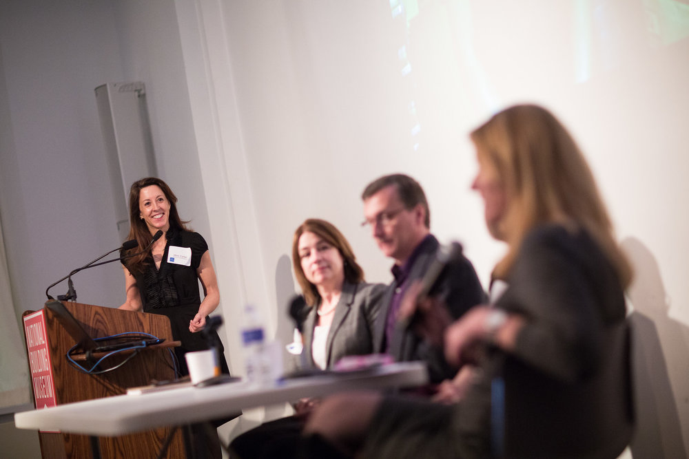 Mimi Carter poses questions to the panelists. Photo by Daniel Schwartz Photography
