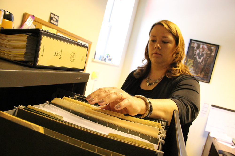 Stephanie Lummus, an attorney the Arch City Defenders, digs through case files.  CREDIT TIM LLOYD | ST. LOUIS PUBLIC RADIO