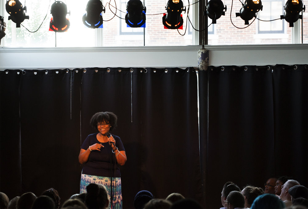 "Cheryl Gunnell tells a story about finding her voice as a young writer during the July 2016""I Live Here"" storytelling event at UrbArts. Photo by Carolina Hidalgo 