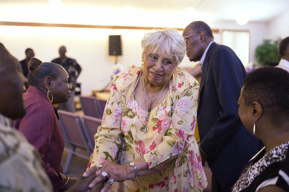 Doris Fiddmont Frazier, center, and other p arishioners worship at Union Baptist Church, a fixture in Westland Acres. The community, founded by a former enslaved man, has existed for more than 200 years and now finds itself sandwiched between two of the region's wealthiest suburbs while being left out of the benefits of the wealthier, whiter areas. PHOTO BY CAROLINA HIDALGO | ST. LOUIS PUBLIC RADIO