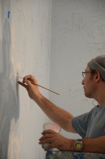Pierre hand painting the wall pattern