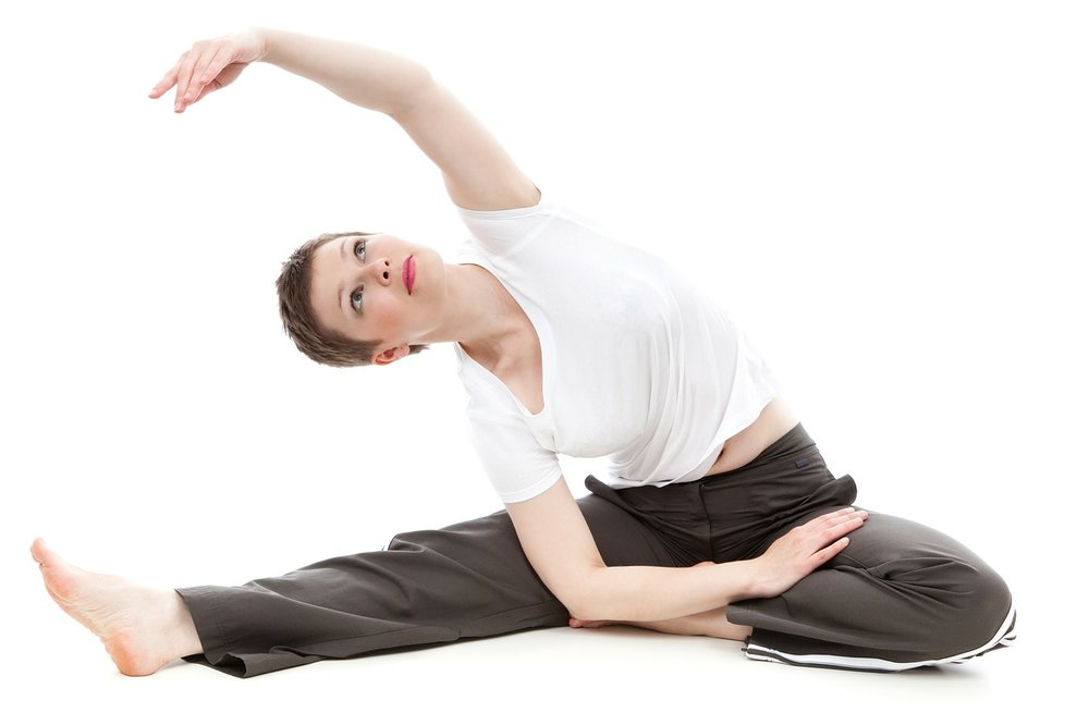 fit & healthy Lady doing yoga stretches