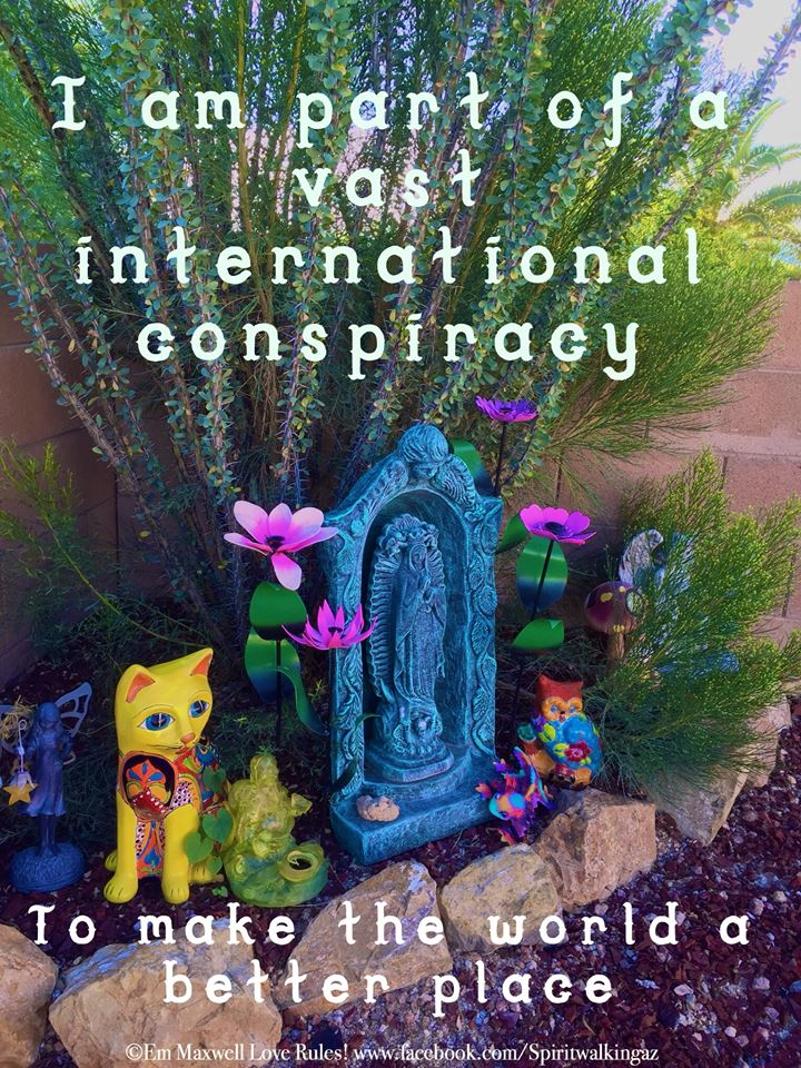 "I am part of a vast international conspiracy to make the world a better place"" quote with statue in a garden"
