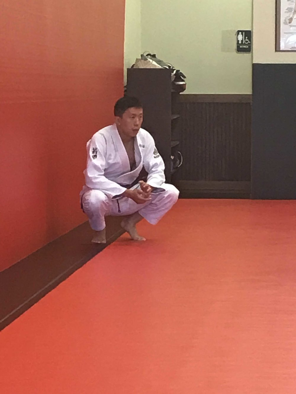 Addi Wei, one of our purple belts under Master Murgel...contemplating life and jiu jitsu techniques.  ;-)