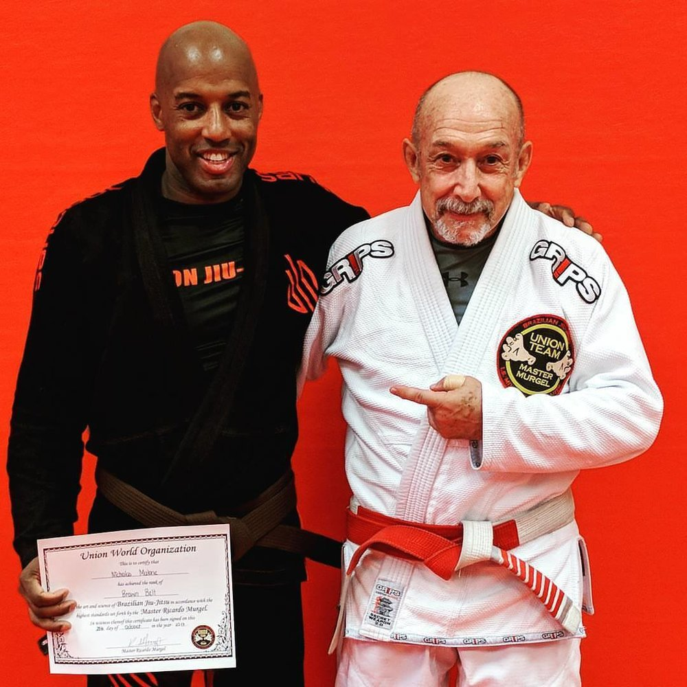 Nicholas with Master Murgel share a smile at his belt promotion last fall. -
