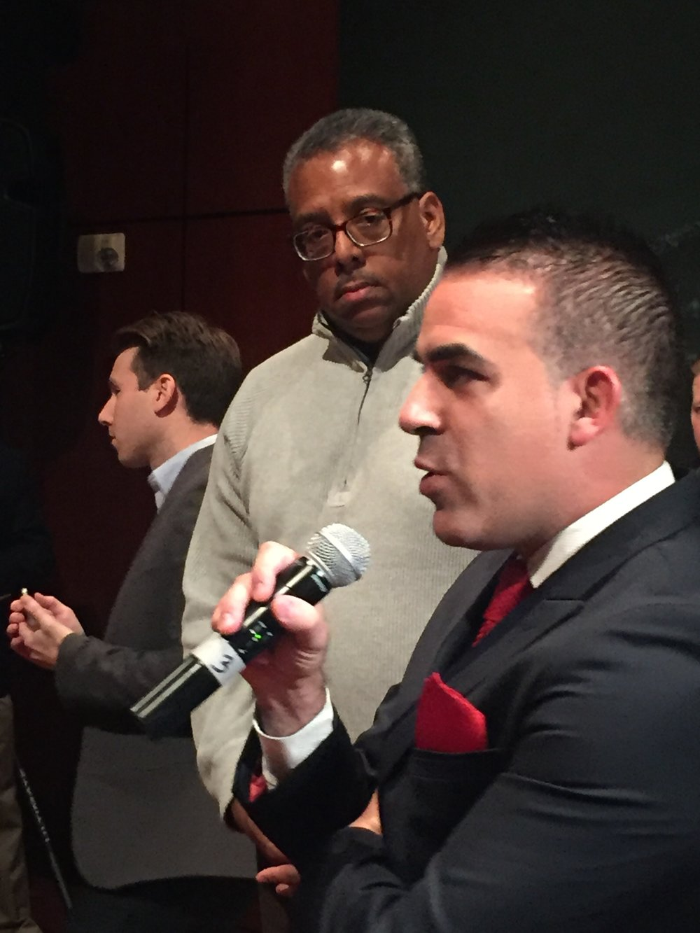 Alex Giron of Carsfera asking questions with Brian Armstead looking on