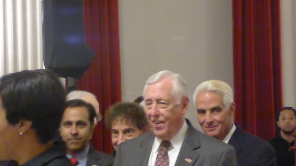 Steny Hoyer with Charlie Christ looking over his shoulder