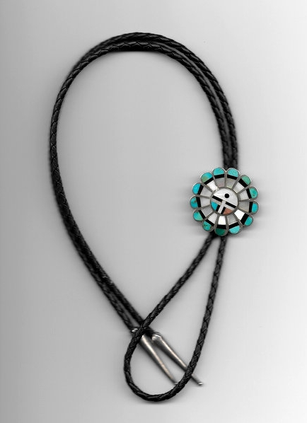 The Bolo Tie was not stolen but is similar to the missing items.