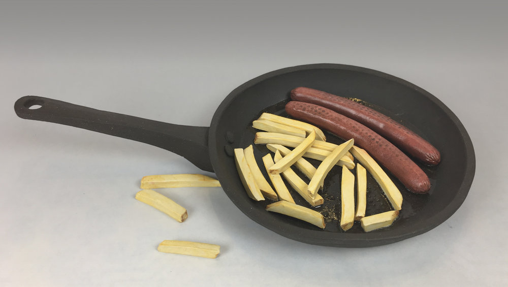 Skillet with Sausages and French Fries