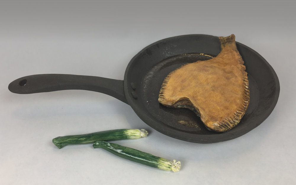 Skillet with Fried Sole Fish