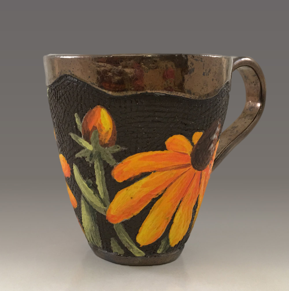Cup with Rudbeckia Flowers