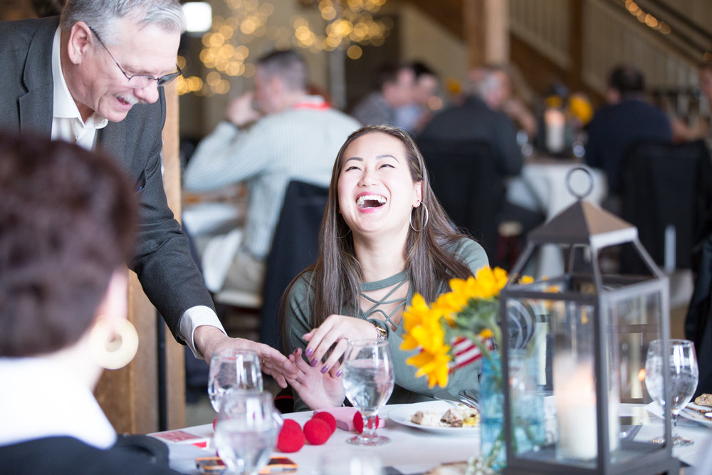 girl laughing at table