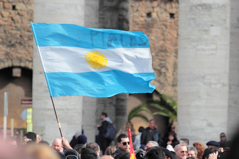 Footsteps of Pope Francis- A pilgrim waves an Argentinian flag for Pope Francis