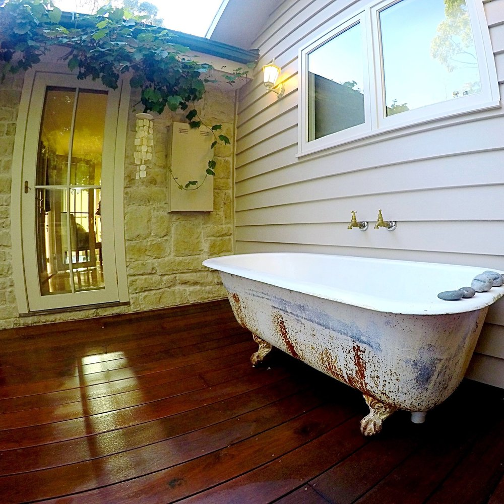 Vintage bath with weatherboard wall cladding