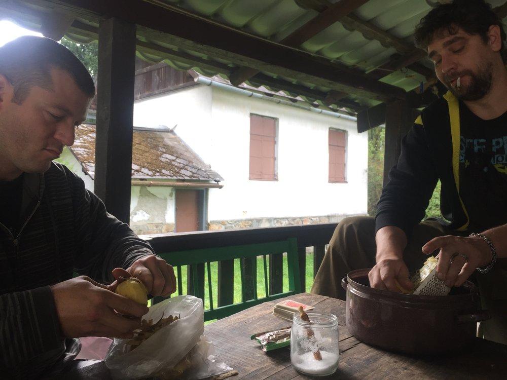 Petr and Ondre making potato pancakes.