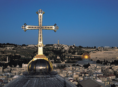 The Golgotha Crucifix atop Jerusalem's Church of the Holy Sepulchre, one of the popular landmarks for Christian tourists visiting Israel. Credit: Markus Bollen - Michael Hammers Studios Gmbh.