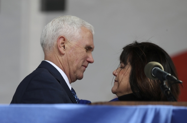 Vice President Mike Pence hugs his wife Karen Pence during the March for Life on the National Mall in Washington, Friday, Jan. 27, 2017. (AP Photo/Manuel Balce Ceneta)