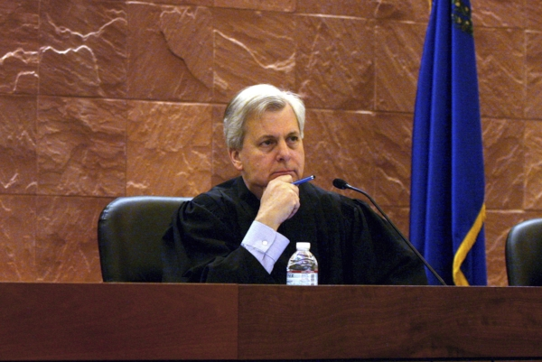 FILE - In this March 19, 2012, file photo, 9th U.S. Court of Appeals Judge Richard Clifton hears the United States vs Rizzolo case in the Thomas & Mack Moot Courtroom in Las Vegas. Clifton is one of three judges on the 9th Circuit Court of Appeals deciding whether to reinstate President Donald Trump's travel ban. (Jeff Scheid/Las Vegas Review-Journal via AP, File)