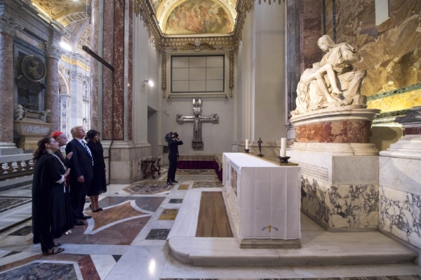 President Donald Trump and his wife Melania looks at Michelangelo's Pieta', during their visit to St. Peter's Basilica at the Vatican, Wednesday, May 24, 2017. (L'Osservatore Romano/Pool Photo via AP)