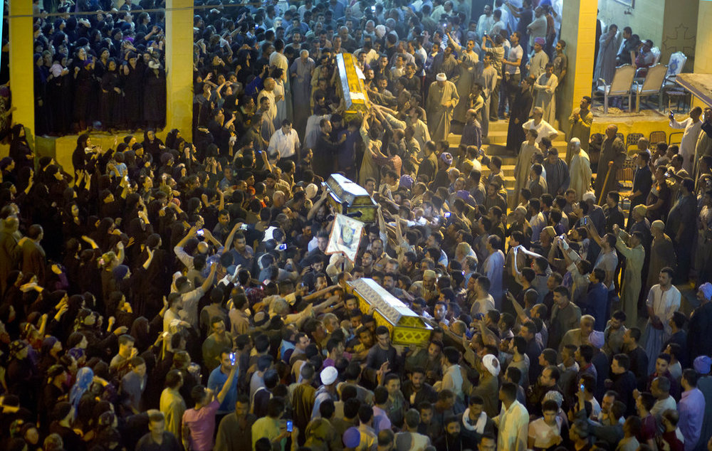Relatives of Coptic Christians carry coffins