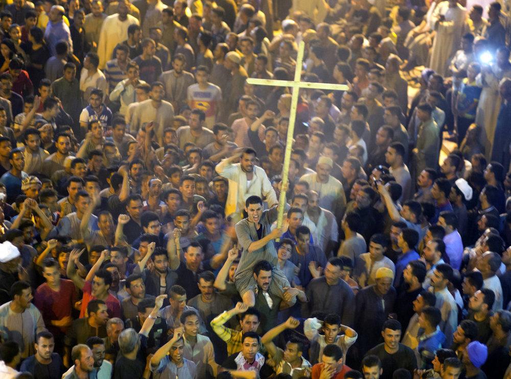 Coptic Christians shout slogans