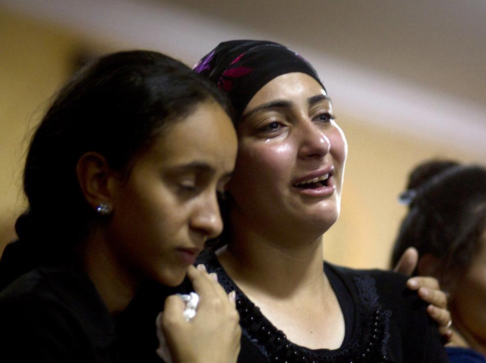Relatives of Coptic Christians killed