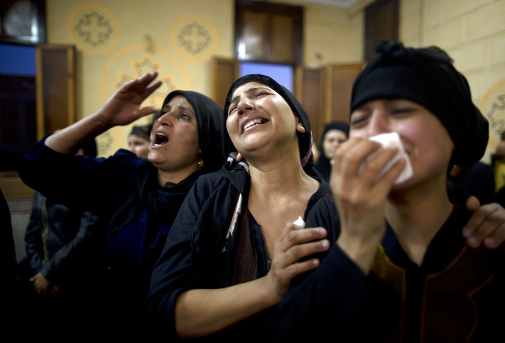 Relatives of killed Coptic Christians grieve during their funeral