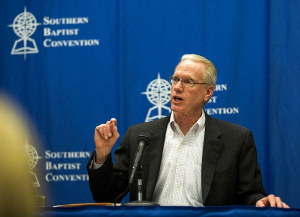 Barrett Duke, chairman of the 2017 Committee on Resolutions, answers questions at a news conference following the passage of nine resolutions on Tuesday, June 13, 2017 in Phoenix. The Southern Baptist Convention, home to prominent evangelical supporters of President Donald Trump, adopted a statement on moral leadership at the group's annual meeting Tuesday that avoided pointed criticism of current political officeholders. (AP Photo/Angie Wang)