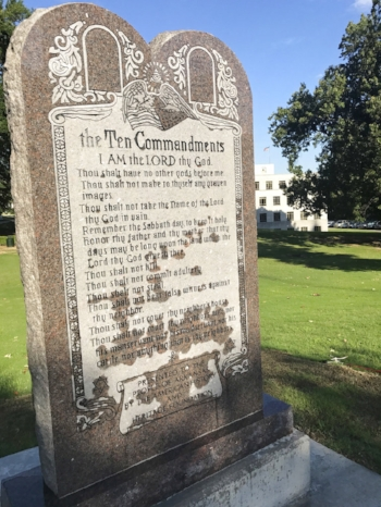 A 6-foot-tall privately funded Ten Commandments monument is seen on the Arkansas Capitol grounds in Little Rock on Tuesday, June 27, 2017, after it was installed by workers two years after lawmakers approved a measure allowing the statue on state property. (AP Photo/Jill Zeman Bleed)