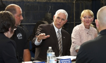 Vice President Mike Pence talks with local small business owners about healthcare during a roundtable at Tendon Manufacturing in Bedford, Ohio, Wednesday, June 28, 2017. (Joshua Gunter/The Plain Dealer via AP)