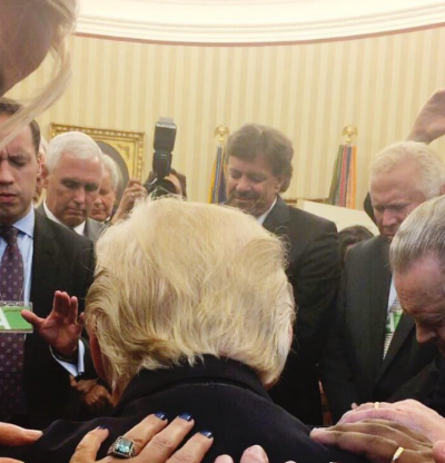 Trump is prayed over by evangelical leaders in the Oval Office. Photo by Johnnie Moore.